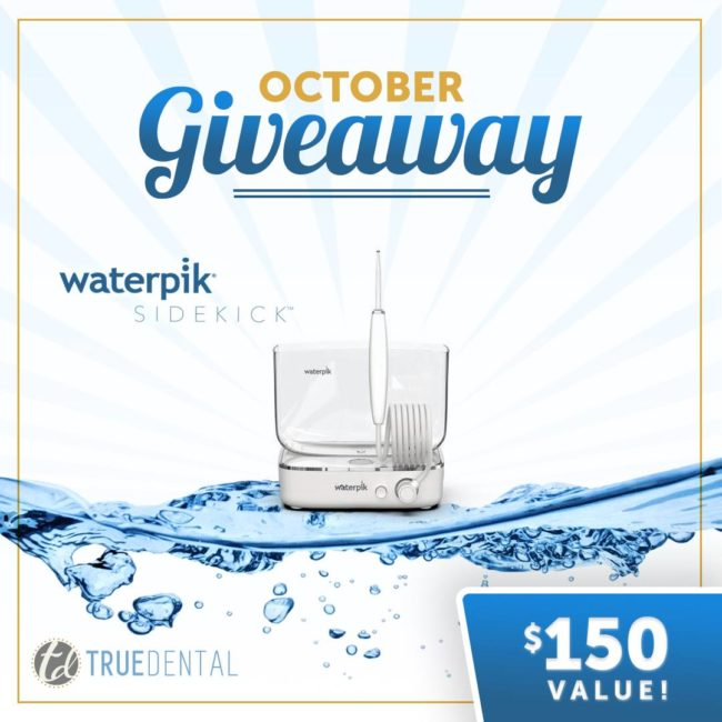 Waterpik picture advertising an October giveaway by True Dental